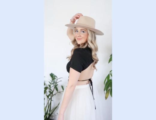 Halifax Blogger Kayla Short Poses in a black shirt hat and tutu skirt