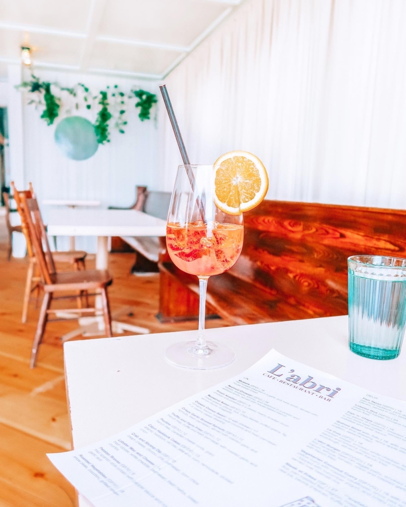 Aperol Spritz sits on a table in Cheticamp Restaurant