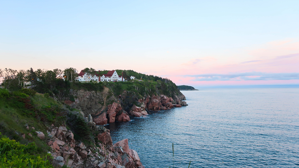 Cliff side view of ketlic lodge at sunset